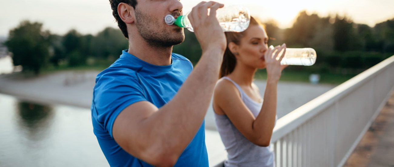 athletic-couple-drinking-water-PZ293T6 (1)